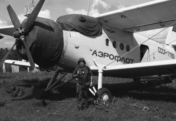 A US serviceman stands in front of a Soviet An-2 aircraft seized at Pearls Airport during the multiservice, multinational Operation URGENT FURY. Photographer's Name: Unknown Location: Date Shot: 10/28/1983 Date Posted: unknown VIRIN: DF-SN-84-10731